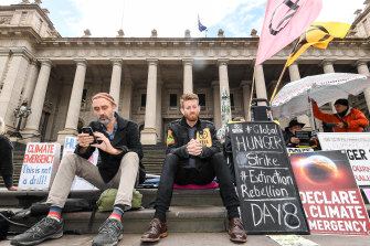 Daniel Bleakley (centre) on the steps of the Victorian Parliament on day 8 of his 10-day hunger strike.