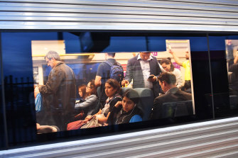 Passengers on an overcrowded V/Line train.