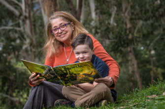 Aunty Joy Wandin Murphy reading her second children's book,  Wilam: A Birrarung Story, to her grandson, Tate Murphy.