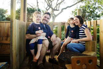 Cam Hollows at home with his wife Jane McKenzie-Hollows and his two daughters Matilda (5) and Tabitha (3.5) in the treehouse he built for them. Hollows' late father Fred was a famous eye doctor.