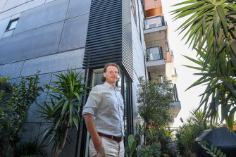 Tony Weir at his Brunswick home, which has been deemed to have flammable cladding - despite evidence it may not.