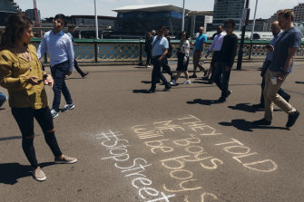 Women's safety advocates spreading the anti-harassment message in chalk.