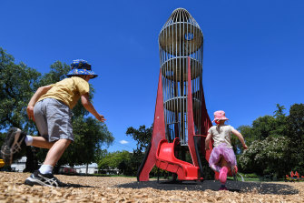 Magnet for kids: Henry and Eloise Gannon play on the rocket tower in Central Gardens, Hawthorn.