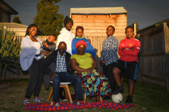 The Manirakiza family are waiting in hope. Pictured are six of Eimable's siblings (rear from left), Harmony, Nicholas, Bienvenue, Deborah, Joshua and Brighton, and (seated) stepfather Dismas and mother Benine.