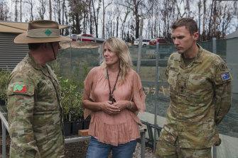 Colonel Warwick Young and Lieutenant Henry Stimson speak with Eurobodalla mayor Liz Innes.