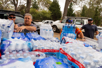 Community members from Russell Vale deliver water, food and other supplies for families affected by bushfires.