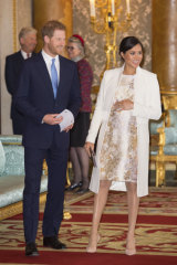 Meghan, Duchess of Sussex, in the gold brocade dress, at a reception to mark the 50th anniversary of the Prince of Wales's investiture.