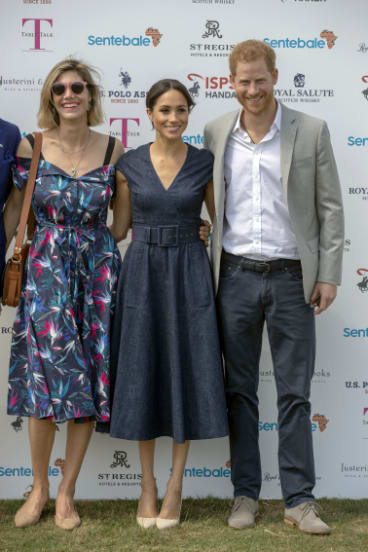 Nacho Figueras, an ambassador for his Sentebale charity, is slightly out of frame while  his fashion designer wife, Delfina Blaquier stands next to Meghan, with Prince Harry, (right).