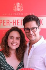 ABC reporter Georgie Tunny and performer Rob Mills in the Piper-Heidsieck tent at the Australian Open on Thursday.
