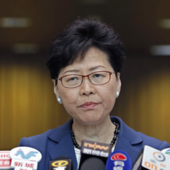 Hong Kong chief executive Carrie Lam vows to push through the new laws despite a strong show of public anger.