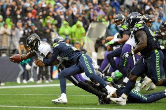 Lamar Jackson runs for a touchdown.