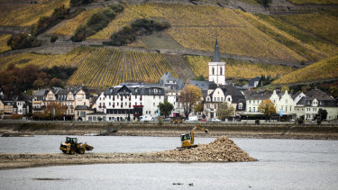 Repairs underway to a groyne during low water levels on the Rhine in Assmanshausen, Germany.