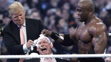 Donald Trump and wrestler Bobby Lashley, shave the head of McMahon at Wrestlemania 23.