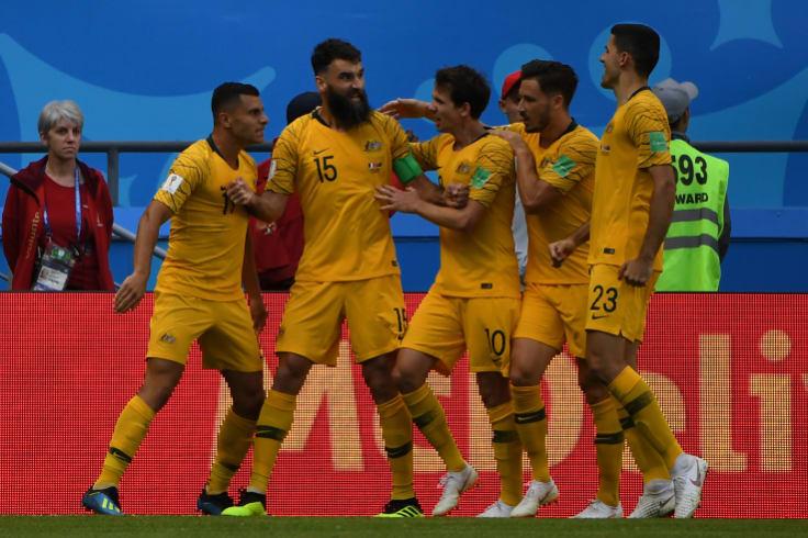 Mile Jedinak celebrates his equalising penalty.