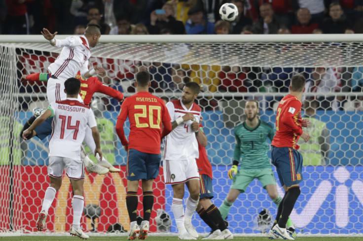 Morocco's Youssef En Nesyri rises to put Morocco ahead.