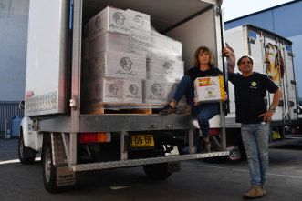 Pepa Saya owner Pierre Issa and partner Melissa Altman in their warehouse in Caringbah, Sydney, Thursday, 15 April 2021. Pepe Saya owner Pierre Issa says Australia Post will no longer deliver perishable food items from June 30 and it will be the biggest distribution to his business since COVID.