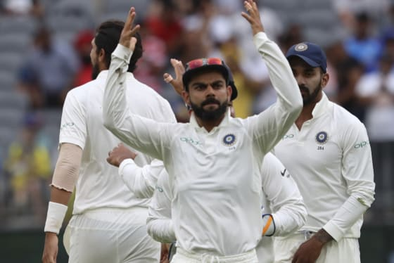 Revved up: Captain Virat Kohli exhorts the crowd to cheer after India claimed the wicket of Australia's Peter Handscomb on day three of the second Test in Perth.