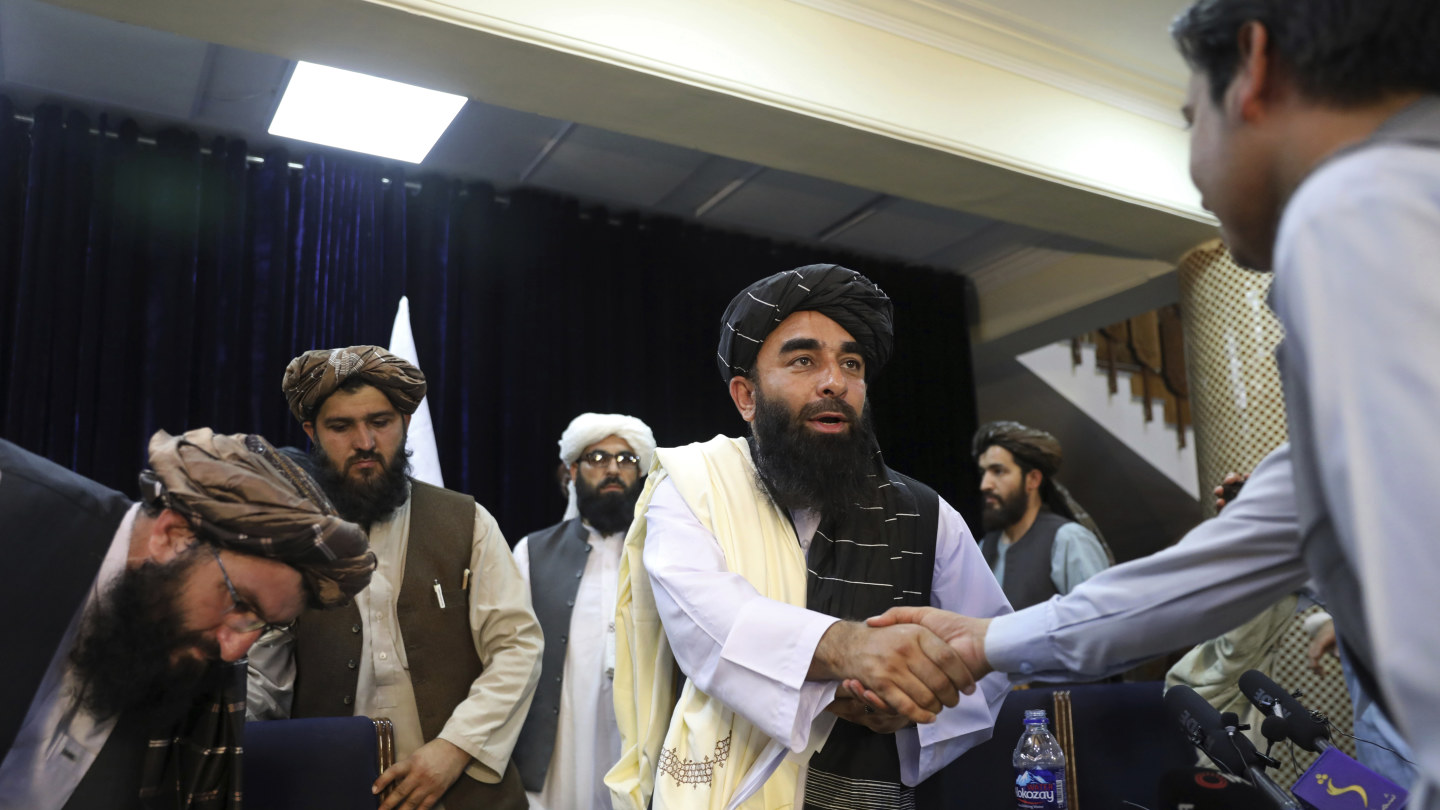 The Taliban is a lot more media savvy now. Its spokesman Zabihullah Mujahid, shook hands with a journalist after his first news conference, in Kabul on  Tuesday.
