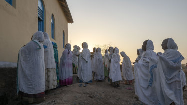 Orthodox Christian Tigrayan refugees who fled the conflict pray in front of a church at Hamdeyat Transition Centre in Sudan near the Ethiopian border.