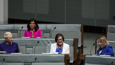 Cathy McGowan MP [C] is surrounded by Dr Kerryn Phelps MP, Julia Banks MP and Rebekha Sharkie MP in the House of Representatives at Parliament House in Canberra.