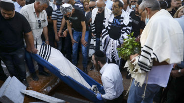 Mourners at the funeral of Yigal Yehoshua in Hadid.