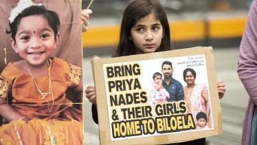 A young girl takes part in a rally in Melbourne supporting the Tamil family seeking asylum on Sunday.