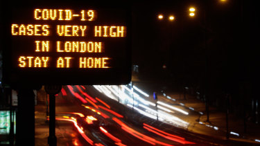 A sign near a highway in London urged people to stay at home.