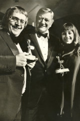 Ernie Sigley and Denise Drysdale with John Wayne at the Logies
