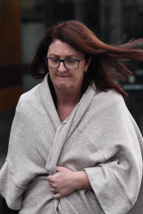 Nicole Smith, former chair of NAB's superannuation trustee Nulis,  leaves the royal commission hearing on August 8.