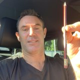Brad Fittler 'pencils in' his NSW Blues team for Origin 1 from his car.