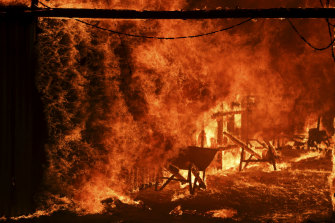 A horse stable burns as a bushfire burning south of Canberra threatens communities in Bumbalong.