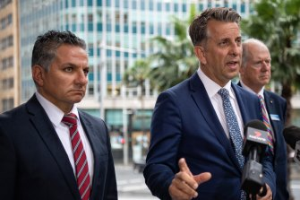 Transport Minister Andrew Constance is joined by the CEO of Sydney Trains Howard Collins, at right, and the NRMA's Peter Khoury in announcing upgrades to the M4 on Monday.