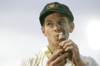 Kiss this: Tim Paine with the Ashes urn.
