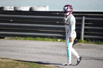 Lewis Hamilton walks back to the pits after car trouble in pre-season testing in Barcelona.