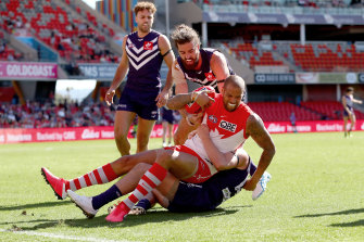 Lance Franklin collects Luke Ryan with his elbow.