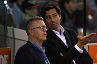 AFL boss Gillon McLachlan and operations manager Steve Hocking are part of the AFL executive that will take a 20 per cent pay cut.