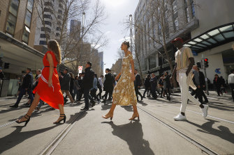 A model wearing Forever New (centre) walks in a pop-up runway at Melbourne Fashion Week.