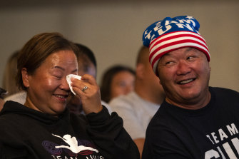 Sunisa Lee's father John (right) and mother Yeev react to her gold medal.
