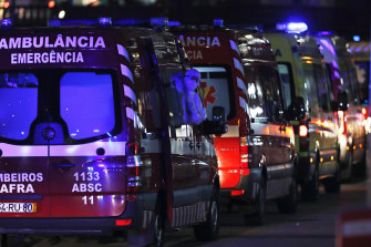 More than 30 ambulances wait to hand over COVID-19 patients to medics at the Santa Maria hospital in Lisbon in January.