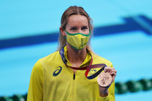 Emma McKeon celebrates her bronze medal.