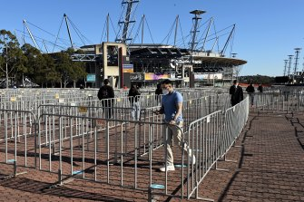 People attending the Qudos Bank Arena mass vaccination hub at Sydney Olympic Park on Monday morning.