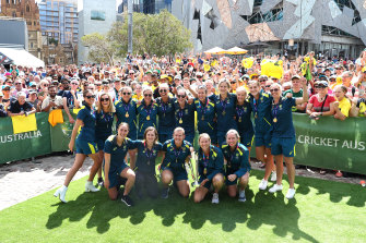 The Australian team celebrates with fans at Fed Square.