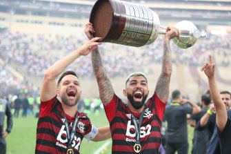 Gabriel Barbosa lifts the trophy after his two late goals secured the win for Flamengo.