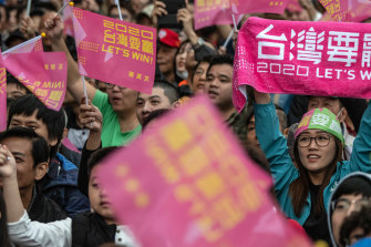 Democratic Progressive Party supporters waved placards as they awaited the results of Saturday's election.