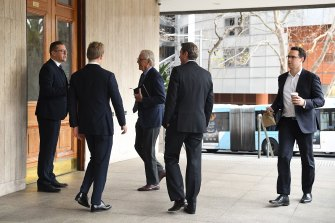 Men arrive at the men's only Australian Club for the vote on whether to allow women as permanent members.