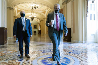 Senate Majority Leader Chuck Schumer arrives ahead of the Senate vote on the $1 trillion infrastructure package.