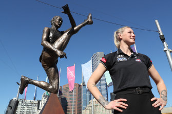 Harris poses with her statue in Melbourne's Federation Square. She knew the abuse would continue after it was unveiled.
