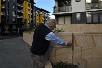 The Building Commissioner inspects a wall with a large gap at Meadowbank in Sydney's north.