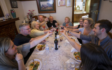 Nonna Lucia Salvati, right rear, and family have lunch after their hard work.