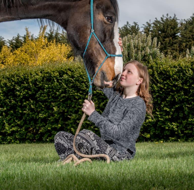 Young survivors of trauma like Shamanii, 13, will do equine therapy with horses like Humphrey on a farm near Creswick.